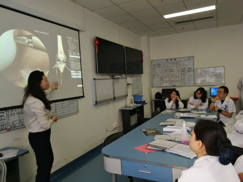 T&E team member Diana in Chengdu delivering a presentation to Sports Medicine surgeons at West China Hospital